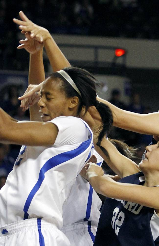Kentucky's Jelleah Sidney, left, pulls down a rebound next to Eckerd's Ivana Grbic and Kristiana Stauere during the first half of an NCAA college basketball exhibition game on Sunday, Nov. 3, 2013, in Lexington, Ky