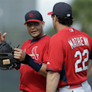 St. Louis Cardinals catcher Yadier Molina, left, talks with manager Mike Matheny during spring training baseball practice Monday, Feb. 24, 2014, in Jupiter, Fla The Associated Press