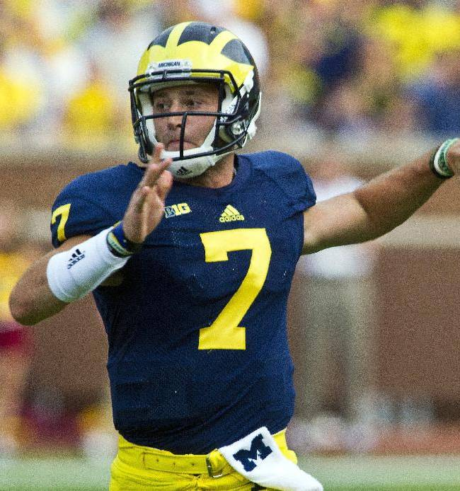 In this Aug. 31, 2013, file photo, Michigan quarterback Shane Morris throws a pass in the third quarter of an NCAA college football game against Central Michigan in Ann Arbor, Mich.  The freshman quarterback will start in place of Devin Gardner in the Buffalo Wild Wings Bowl on Saturday, Dec. 28, 2013, against Kansas State in Tempe, Ariz. Gardner sustained a turf toe injury in the Wolverines' final regular-season game against Ohio State