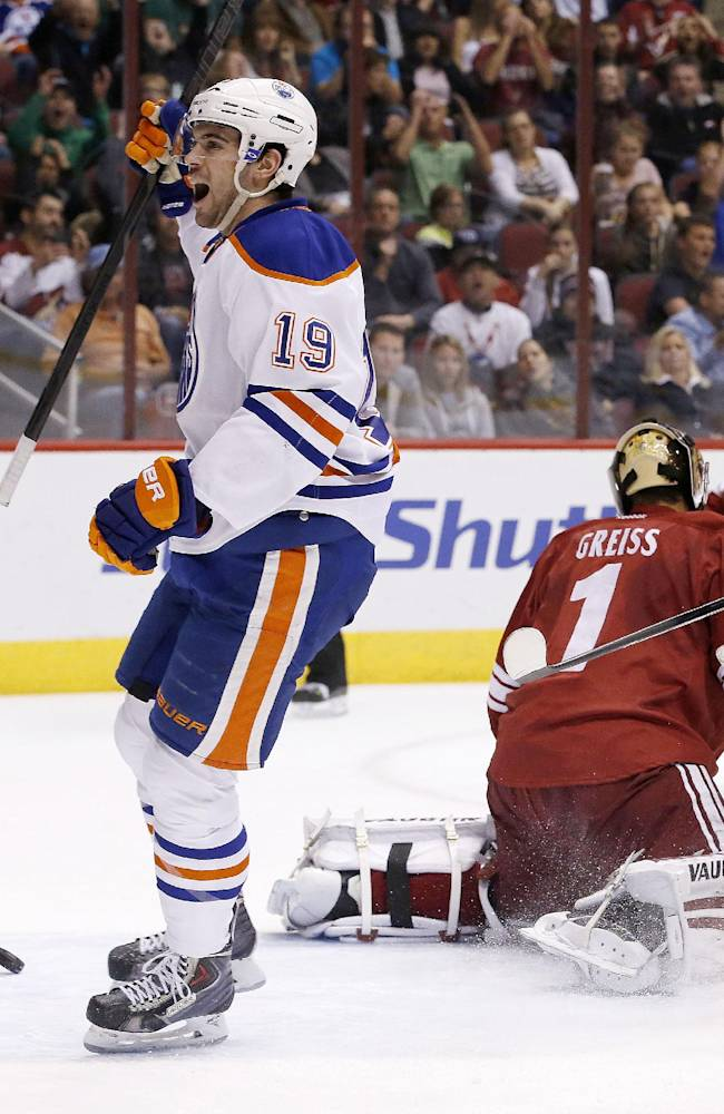 Edmonton Oilers' Justin Schultz (19) celebrates his goal against Phoenix Coyotes' Thomas Greiss (1), of Germany, during the first period of an NHL hockey game, Friday, April 4, 2014, in Glendale, Ariz