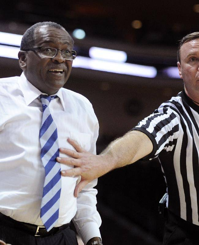 Bakersfield coach Rod Barnes, left, is held back by a referee as he questions a call during the first half of an NCAA college basketball game against Chicago State in the first round of the West Athletic Conference men's tournament Thursday, March 13, 2014, in Las Vegas