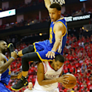 HOUSTON, TX - MAY 25: Stephen Curry #30 of the Golden State Warriors falls over Trevor Ariza #1 of the Houston Rockets on his way to an injury in the second quarter during Game Four of the Western Conference Finals of the 2015 NBA Playoffs at Toyota Center on May 25, 2015 in Houston, Texas. (Photo by Ronald Martinez/Getty Images)