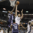 Charlotte Bobcats forward Michael Kidd-Gilchrist (14) blocks a shot by Memphis Grizzlies center Marc Gasol (33), of Spain, in the second half of an NBA basketball game Saturday, March 8, 2014, in Memphis, Tenn. The Grizzlies won 111-89 The Associated Pres