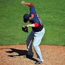 Boston Red Sox pitcher Junichi Tazawa goes through his pre-pitch routine on the mound during the fifth inning of an exhibition spring training baseball game between the Pittsburgh Pirates and the Red Sox in Bradenton, Fla., Monday, March 3, 2014. The Pira