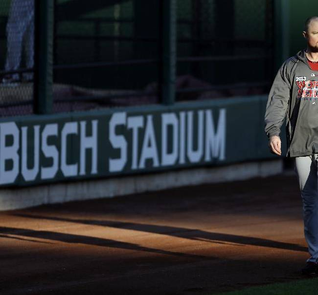 Boston Red Sox pitcher Jon Lester walks in the outfield during baseball practice Friday, Oct. 25, 2013, at Busch Stadium in St. Louis. The Red Sox and St. Louis Cardinals are set to play Game 3 of the World Series scheduled for Saturday in St. Louis