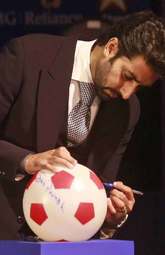 Abhishek Bachchan, Bollywood actor and co-owner of Team Chennai, signs a soccer ball during the official launch of the Indian Super League (ISL) in Mumbai, India, Thursday, Aug. 28, 2014. The ISL, an initiative to popularize soccer in the country, is scheduled to begin Oct. 12