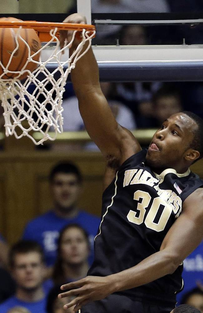 Wake Forest's Travis McKie (30) dunks against Duke during the first half of an NCAA college basketball game in Durham, N.C., Tuesday, Feb. 4, 2014