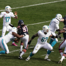 Miami Dolphins quarterback Ryan Tannehill (17) throws a pass against the Chicago Bears during the first half of an NFL football game Sunday, Oct. 19, 2014 in Chicago The Associated Press
