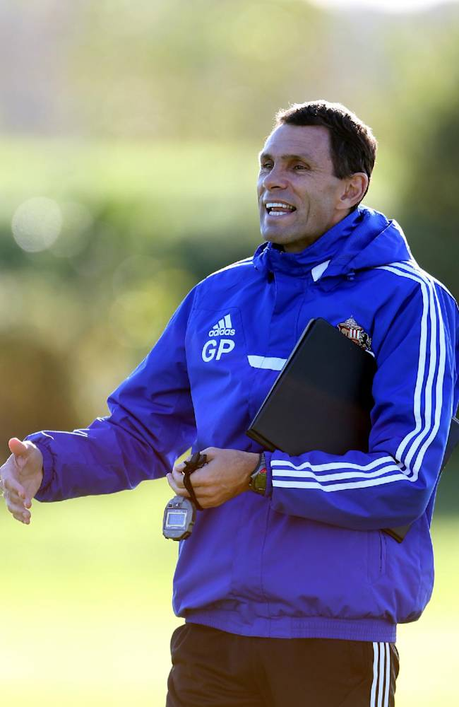 Sunderland's manager Gus Poyet watches his squad, during a training session at the club's training ground,  in Sunderland, England, Thursday Oct. 24, 2013. Sunderland will play Newcastle United in a Premier League match on Sunday