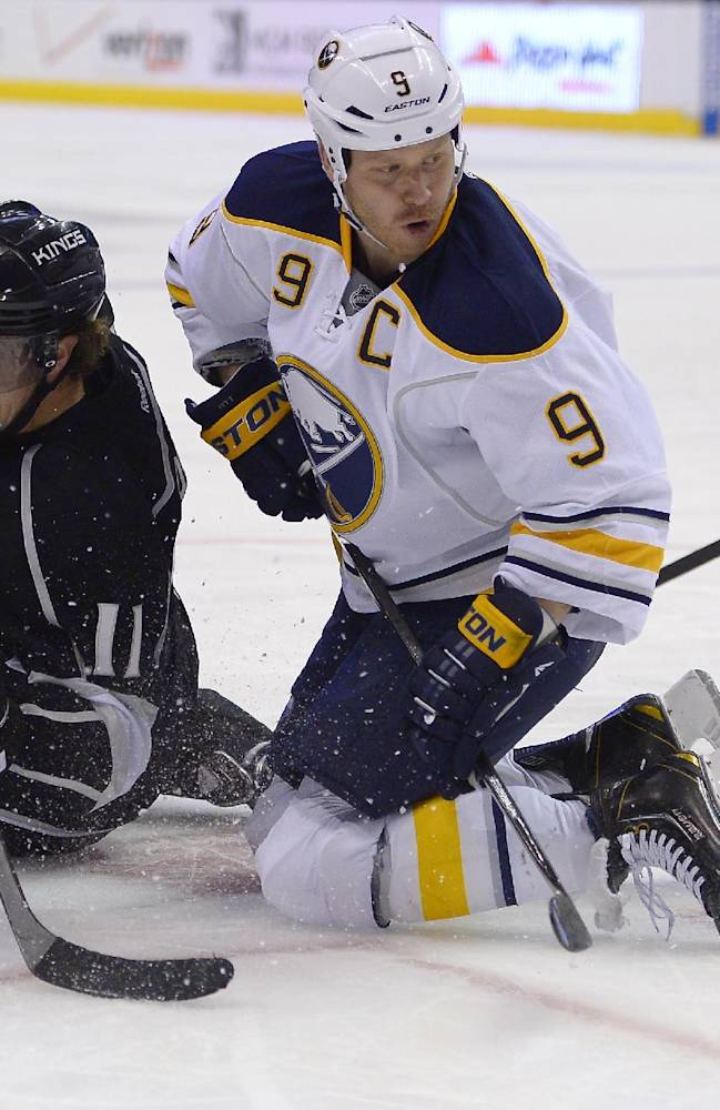 Los Angeles Kings center Anze Kopitar, left, of Slovenia, battles for a face-off with Buffalo Sabres center Steve Ott during the second period of an NHL hockey game, Thursday, Nov. 7, 2013, in Los Angeles