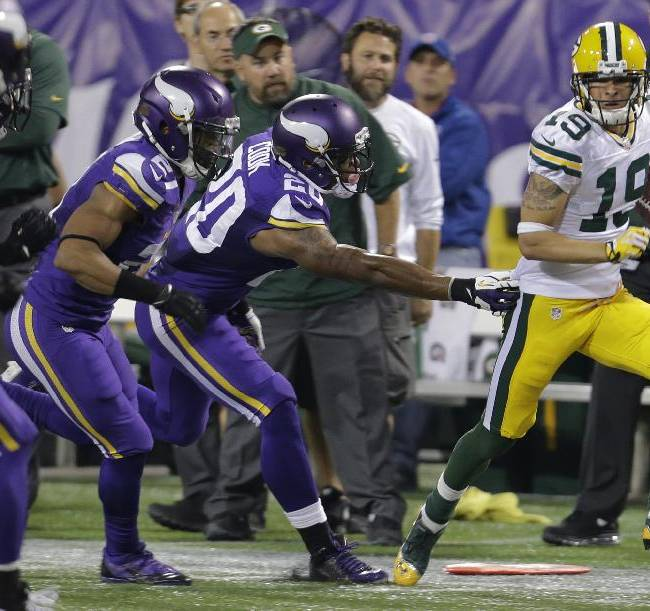 Green Bay Packers wide receiver Myles White (19) rushes against Minnesota Vikings defense in the second half of an NFL football game, Sunday, Oct. 27, 2013, in Minneapolis