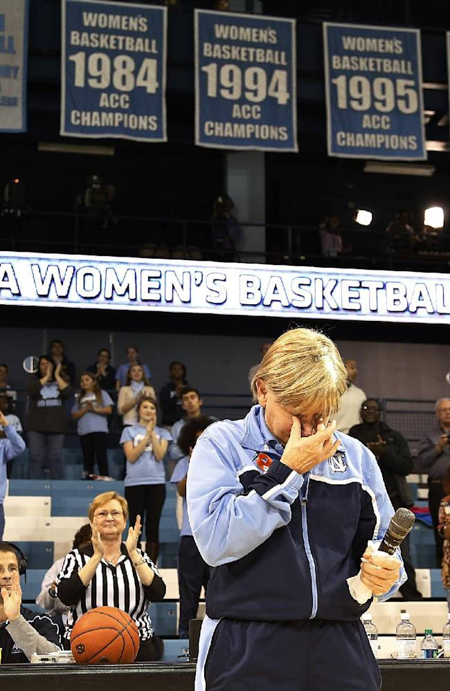 North Carolina head coach Sylvia Hatchell, foreground, gets emotional as she addresses the crowd at halftime of an NCAA women's college basketball game against Maryland in Chapel Hill, N.C., Sunday, Jan. 5, 2014. Maryland won the game 79-70. The Hall of Fame coach has been out all year while she receives treatment for leukemia