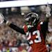 FILE - In this Jan. 20, 2013 file photo, Atlanta Falcons cornerback Dunta Robinson celebrates after stripping the ball from San Francisco 49ers' Michael Crabtree during the second half of the NFL football NFC Championship game in Atlanta. The Falcons have released running back Michael Turner, defensive end John Abraham and Robinson. The moves were announced Friday, March 1, 2013, by a team that came up just short of the Super Bowl. (AP Photo/David Goldman)