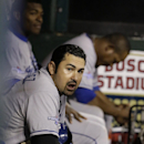 Los Angeles Dodgers' Adrian Gonzalez on the bench during the ninth inning of Game 6 of the National League baseball championship series against the St. Louis Cardinals Friday, Oct. 18, 2013, in St. Louis The Associated Press