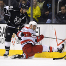 Los Angeles Kings center Mike Richards, left, and Carolina Hurricanes center Eric Staal vie for the puck during the second period of an NHL hockey game, Saturday, March 1, 2014, in Los Angeles The Associated Press