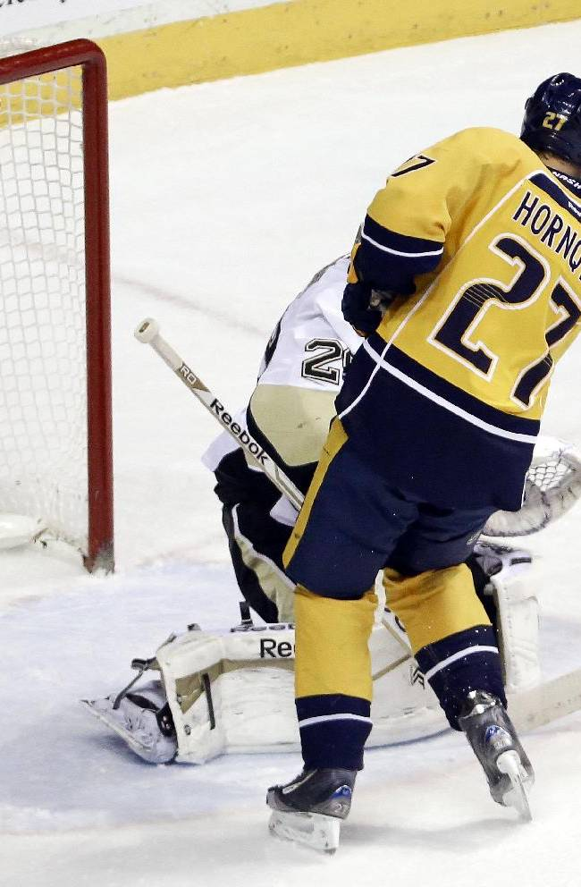 A shot deflected by Nashville Predators forward Patric Hornqvist (27), of Sweden, hits the crossbar behind Pittsburgh Penguins goalie Marc-Andre Fleury (29) in the second period of an NHL hockey game Tuesday, March 4, 2014, in Nashville, Tenn