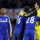 Chelsea's Didier Drogba, left, John Terry, 2nd left, Cesar Azpilicueta and Thibaut Courtois, right, celebrate winning the English League Cup semifinal second leg soccer match between Chelsea and Liverpool at Stamford Bridge stadium in London, Tuesday, Jan