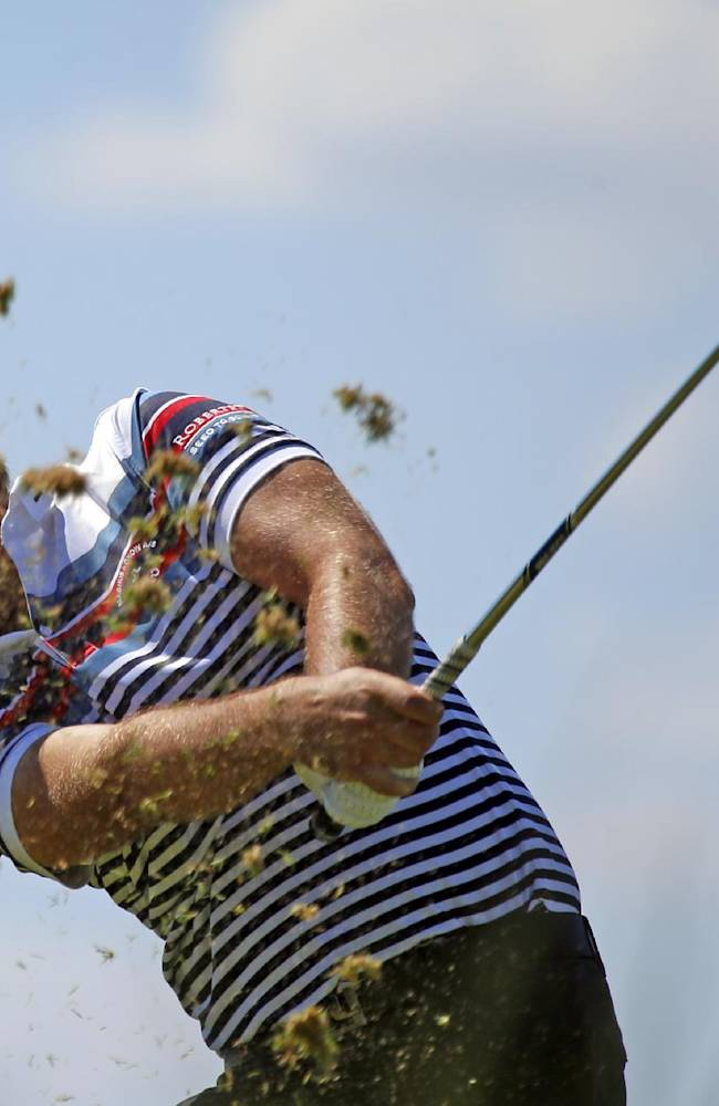 Victor Dubuisson of France tees of during the first day of the French Open Golf tournament at Paris National course in Guyancourt, west of Paris, France, Thursday, July 3, 2014
