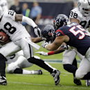 Oakland Raiders' Phillip Adams runs with the ball after recovering a fumble by Houston Texans' Garrett Graham during the first half of an NFL football game Sunday, Nov. 17, 2013, in Houston The Associated Press
