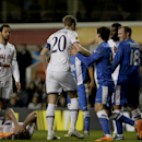 Tottenham's Michael Dawson, center 20, shouts at Dnipro's Roman Zozulya, 18 right, after an incident with Jan Vertonghen, lying on floor, for which the referee sent off Zozulya for a headbutt during the Europa League Group K soccer match between Tottenham