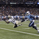In this Aug. 15, 2014, file photo, New Orleans Saints wide receiver Joe Morgan (13) pulls in a pass reception in the first half of an NFL preseason football game against the Tennessee Titans in New Orleans. Morgan's two long catches in New Orleans' most r