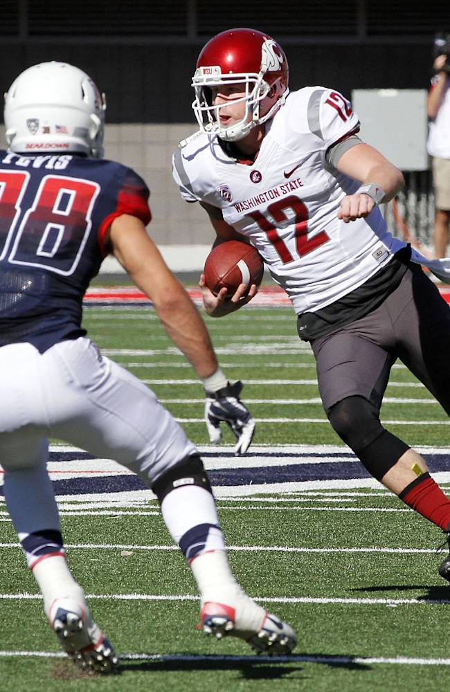 Halliday throws for 319 yards, WSU upsets Arizona