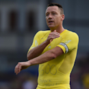Chelsea's John Terry shows his shirt to the Chelsea's fans following their English Premier League soccer match against Crystal Palace, his 500th as captain, at Selhurst Park, London, Saturday, Oct. 18, 2014