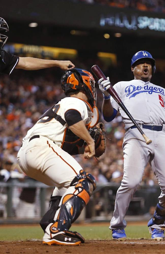 Los Angeles Dodgers' Juan Uribe reacts to home plate umpire Adam Hamari's strikeout call during the seventh inning of a baseball game against the San Francisco Giants, Saturday, July 26, 2014, in San Francisco. (AP Photo/Beck Diefenbach)