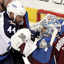 Winnipeg Jets' Zach Bogosian (44) gets tangled up with Colorado Avalanche goalie Semyon Varlamov (1 ) during the first period of an NHL hockey game on Monday, March 10, 2014 in Denver The Associated Press