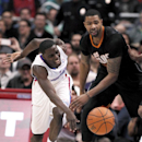 Phoenix Suns forward Marcus Morris, right, knocks the ball away from Los Angeles Clippers guard Darren Collison, left, during the second half of an NBA basketball game Monday, March 10, 2014, in Los Angeles. Clippers won 112-105 The Associated Press