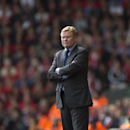Southampton's manager Ronald Koeman stands on the touchline as his side are beaten 2-1 at Liverpool during their English Premier League soccer match at Anfield Stadium, Liverpool, England, Sunday Aug. 17, 2014