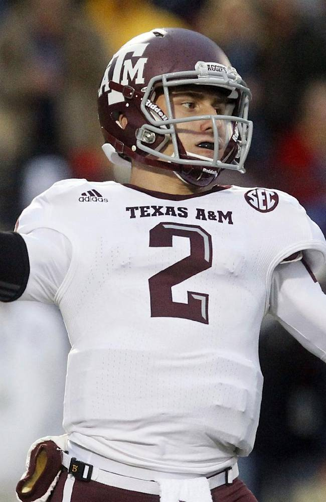 In this Oct. 6, 2012, file photo, Texas A&M quarterback Johnny Manziel throws a short pass in the first quarter of an NCAA college football game against Mississippi in Oxford, Miss. A record 98 underclassmen, including Manziel, have made themselves eligible for the NFL draft in May