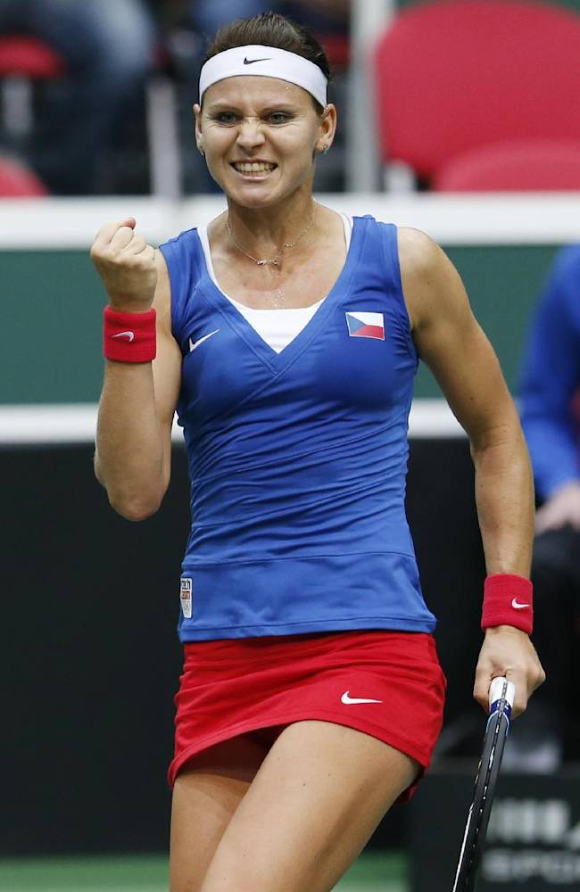 Czech Republic's Lucie Safarova celebrates after defeating Italy's Sara Errani in a Fed Cup semifinal tennis match in Ostrava, Czech Republic, Saturday, April 19, 2014. Safarova won the match and gave Czech Republic a 1-0 lead