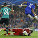 Chelsea's Didier Drogba jumps over Schalke's goalkeeper Ralf Faehrmann beside Kaan Ayhan, left, during the Champions League Group G soccer match between Chelsea and Schalke 04 at Stamford Bridge stadium in London Wednesday, Sept. 17, 2014