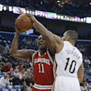 New Orleans Pelicans guard Eric Gordon (10) fouls Milwaukee Bucks guard Brandon Knight (11) during the first half of an NBA basketball game in New Orleans, Friday, March 7, 2014 The Associated Press