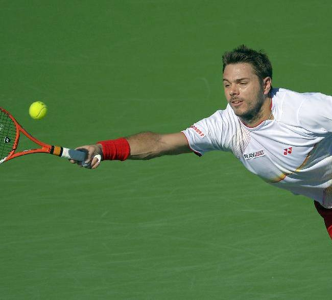 Stanislas Wawrinka, of Switzerland, returns a shot against Kevin Anderson, of South Africa, during a fourth round match at the BNP Paribas Open tennis tournament, Wednesday, March 12, 2014, in Indian Wells, Calif