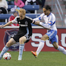 Chicago Fire midfielder Jeff Larentowicz (20), left, controls the ball against Montreal Impact midfielder Issey Nakajima-Farran (17) during the second half of an MLS soccer game on Sunday, Oct. 5, 2014, in Bridgeview, Ill. The teams tied 0-0 The Associate