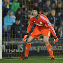Chelsea goalkeeper Petr Cech watches the ball, during the Fourth Round of the English League Cup soccer match between Shrewsbury Town and Chelsea at Greenhous Meadow, Shrewsbury, England, Tuesday, Oct. 28, 2014