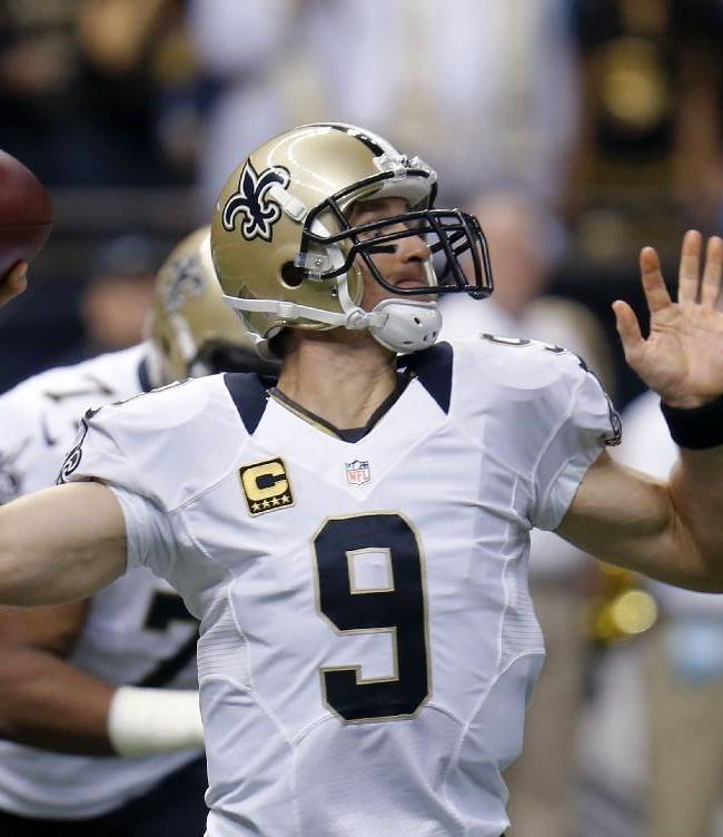 New Orleans Saints quarterback Drew Brees (9) passes in the first half of an NFL football game against the Miami Dolphins in New Orleans, Monday, Sept. 30, 2013