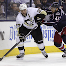 Pittsburgh Penguins' Craig Adams, left, looks for an open pass as Columbus Blue Jackets' Artem Anisimov, of Russia, defends during the first period of an NHL preseason hockey game Tuesday, Sept. 23, 2014, in Columbus, Ohio. The Associated Press
