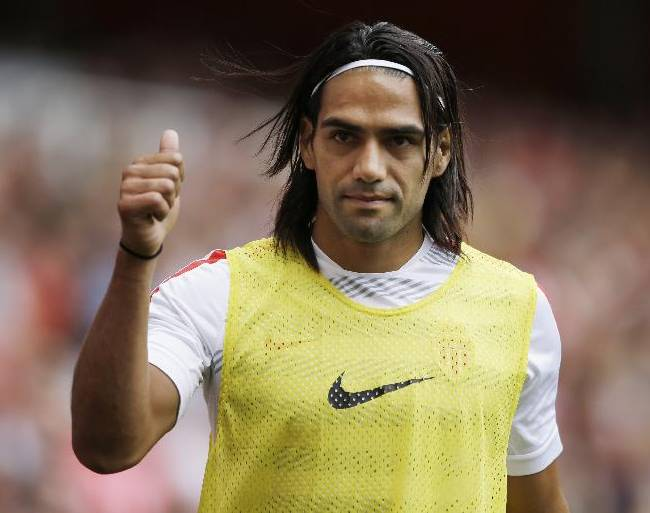 This is a Saturday, Aug. 2, 2014  file photo of AS Monaco player Radamel Falcao  as he gives a thumbs up to fans as he warms up on the sideline during the second half of the Emirates Cup soccer match between AS Monaco and Valencia at Arsenal's Emirates Stadium in London.  Radamel Falcao is set to join Manchester United on loan after the Premier League club agreed to a loan deal with Monaco, a person with knowledge of the deal said Monday Sept. 1, 2014