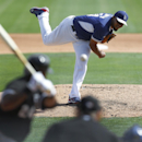 Los Angeles Dodgers pitcher Kenley Jansen, top, throws to Chicago White Sox's Dayan Viciedo during an exhibition baseball game in Glendale, Ariz., Friday, Feb. 28, 2014 The Associated Press