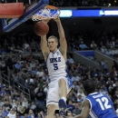 Duke's Mason Plumlee, left, dunk the ball as Creighton's Jahenns Manigat looks on during the second half of a third-round game of the NCAA college basketball tournament, Sunday, March 24, 2013, in Philadelphia. Duke won 66-50. (AP Photo/Michael Perez)