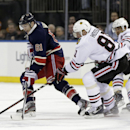 New York Rangers left wing Rick Nash (61) defends Chicago Blackhawks right wing Marian Hossa (81), of Slovakia, during the first period of an NHL hockey game at Madison Square Garden in New York, Thursday, Feb. 27, 2014 The Associated Press