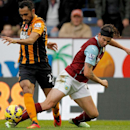 Hull City's Ahmed Elmohamady, left, and Burnley's George Boyd challenge for the ball during their English Premier League soccer match at Turf Moor, Burnley, England, Saturday, Nov. 8, 2014