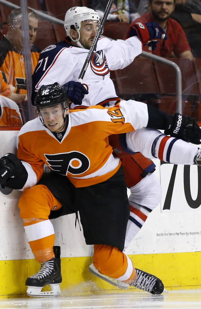 Philadelphia Flyers' Michael Raffl, front, of Austria, and Columbus Blue Jackets' Nick Foligno collide during the second period of an NHL hockey game, Thursday, April 3, 2014, in Philadelphia