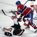 Montreal Canadiens defenseman Andrei Markov (79) knocks Ottawa Senators defenseman Chris Phillips (4) to the ice in front of