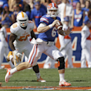 Florida quarterback Jeff Driskel (6) looks for a receiver as his is chased by Tennessee defensive lineman Corey Vereen (50) during the first half of an NCAA college football game in Gainesville, Fla., Saturday, Sept. 21, 2013 The Associated Press