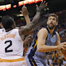 Memphis Grizzlies' Marc Gasol, of Spain, looks to shoot as Phoenix Suns' Eric Bledsoe (2) defends during the first half of an NBA basketball game, Monday, April 14, 2014, in Phoenix The Associated Press