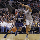 Memphis Grizzlies' Zach Randolph (50) drive the ball against the San Antonio Spurs' Boris Diaw (33) during the first quarter of an NBA basketball game, Sunday, April 6, 2014, in San Antonio The Associated Press